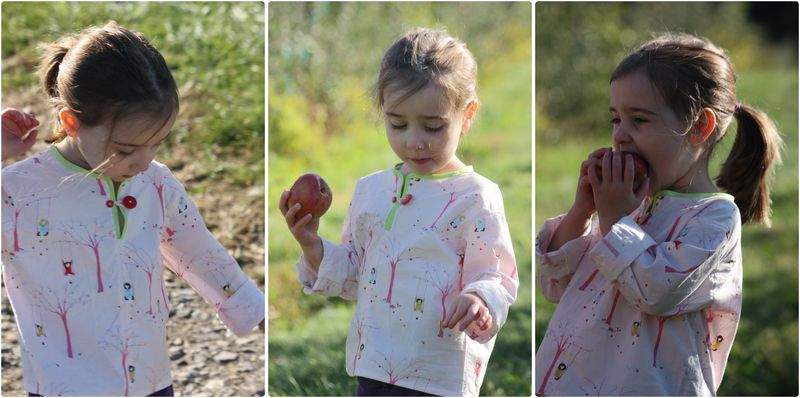 Violet apple eating in shirt